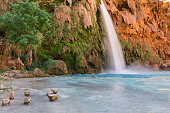 Stumps for sitting in the pool below Havasu Falls on the Havasupai Indian Reservation in the Grand Canyon.