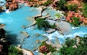 Havasupai Falls, pools, blue water, geological formation rock walls Indian Reservation in the top of the Grand Canyon National Park Desert