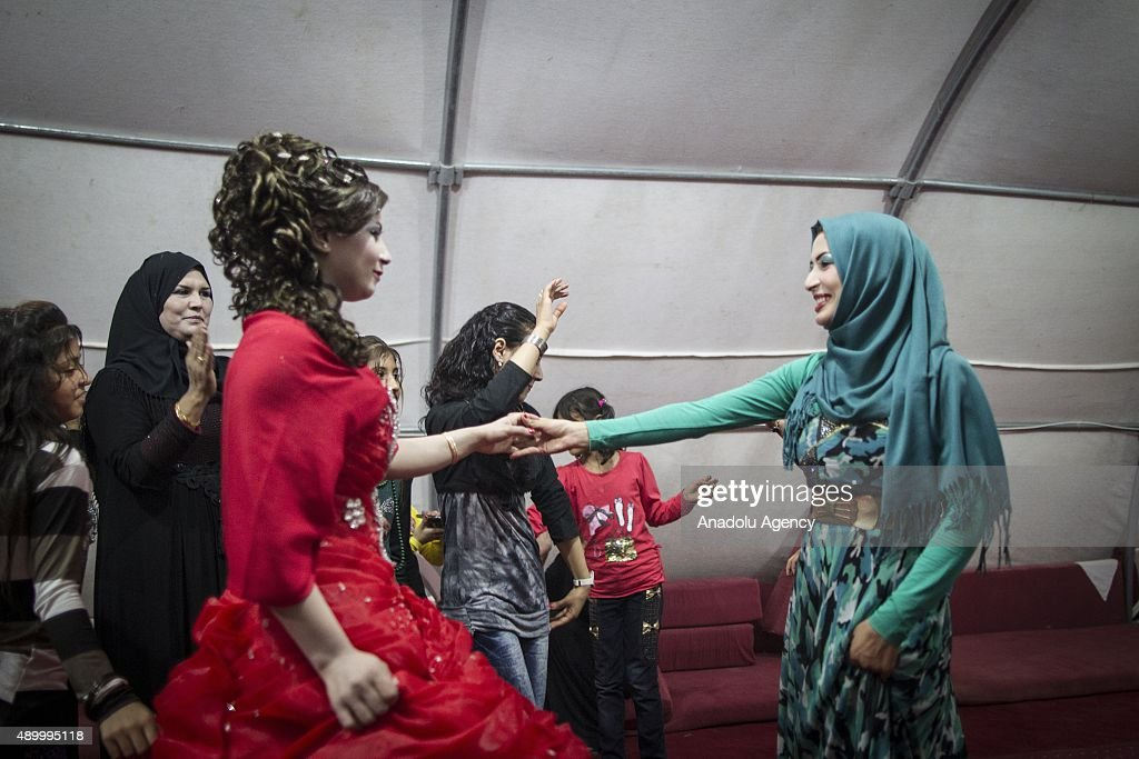 Havazi Hilen, 17, a refugee girl who fled Syria three months ago with her family, dances with her relatives during her henna night at a tent city in the Akcakale District of Sanliurfa, Turkey on September 24, 2015. Hilen got married with her uncle's son Ahmet Elabid. 260 thousand Syrians who have escaped war and found asylum in Turkey are now living in camps with opportunities that mean they don't miss what they've left behind.