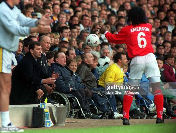 controversial Middlesbrough star Emerson throws the ball to manager Bryan Robson during the vital game against Leeds yesterday where Emerson was...