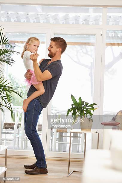 Having a fun moment dancing with dad