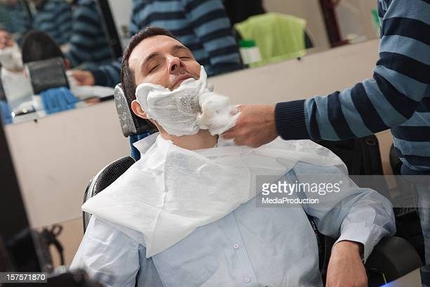 Having a shave at the barbers
