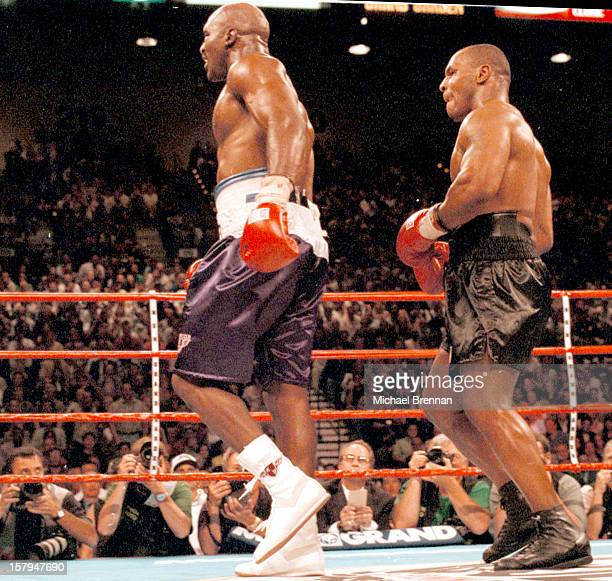 Having bitten Evander Holyfield's right ear boxer Mike Tyson pursues and pushes him into his corner during a fight at the MGM Grand Hotel and Casino...