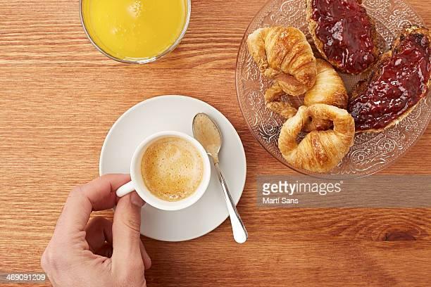 Having breakfast in wooden table