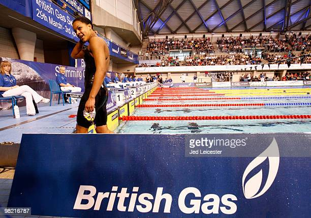 Having climbed out of the pool Achieng AjuluBushell walks past the British Gas advertising boards at the British Gas Swimming Championships event at...