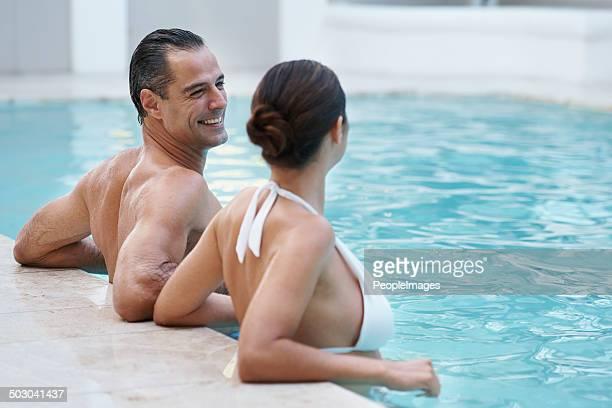 Having fun in the pool with his beautiful wife