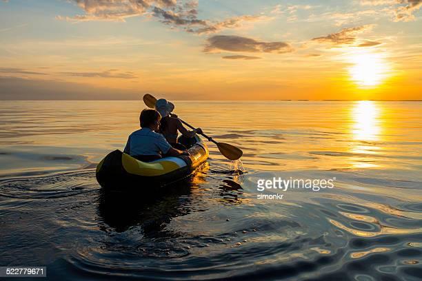 Having Fun Sea Kayaking At Sunset