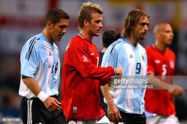 Having just given his side the lead England's David Beckham walks off at halftime alongside Argentina's Diego Simeone and Gabriel Batistuta