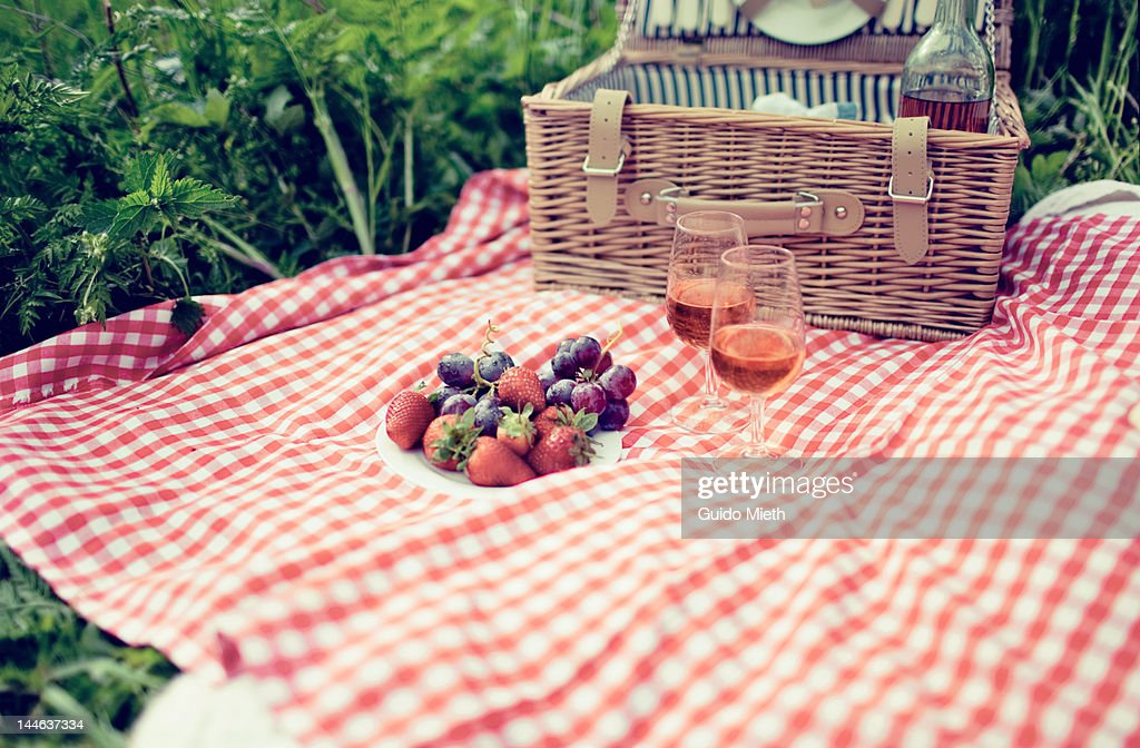 Having picnic in meadow.
