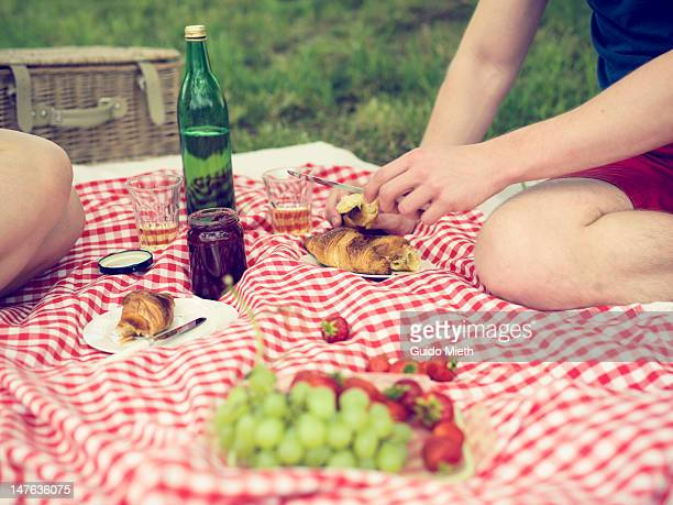 Having picnic in meadow.
