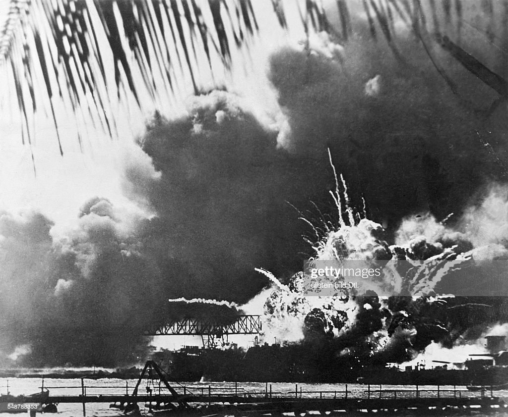 Attack on Pearl Harbor by the Imperial Japanese Navy on December 7 1941 Explosion of the destroyer 'Shaw' after being hit by a torpedo on the right...