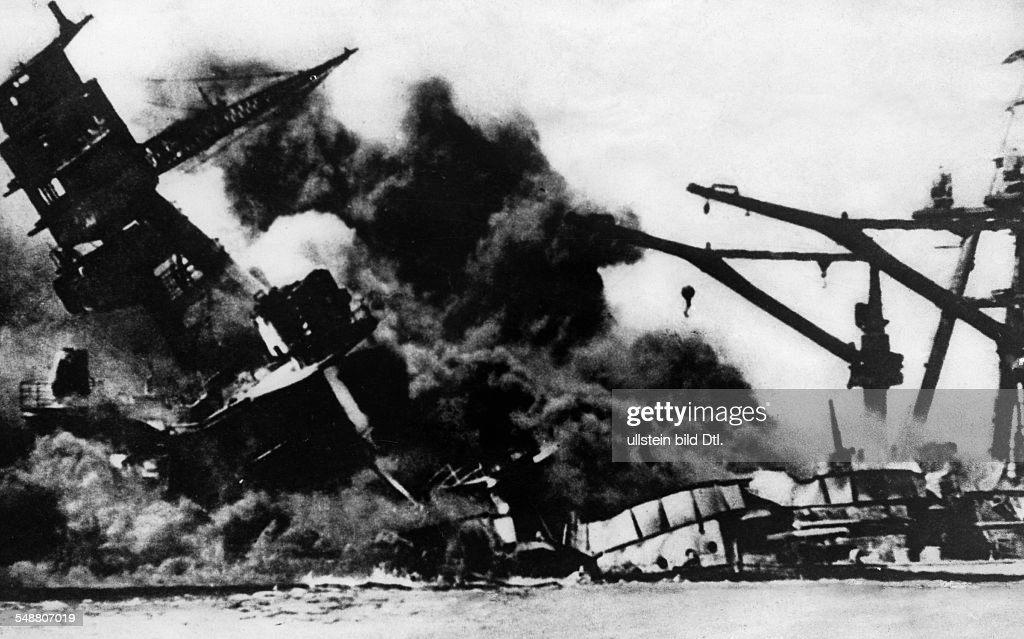 Attack on Pearl Harbor by the Imperial Japanese Navy on December 7 1941 Sinking of the battleship 'Arizona' causing a huge cloud of smoke identical...