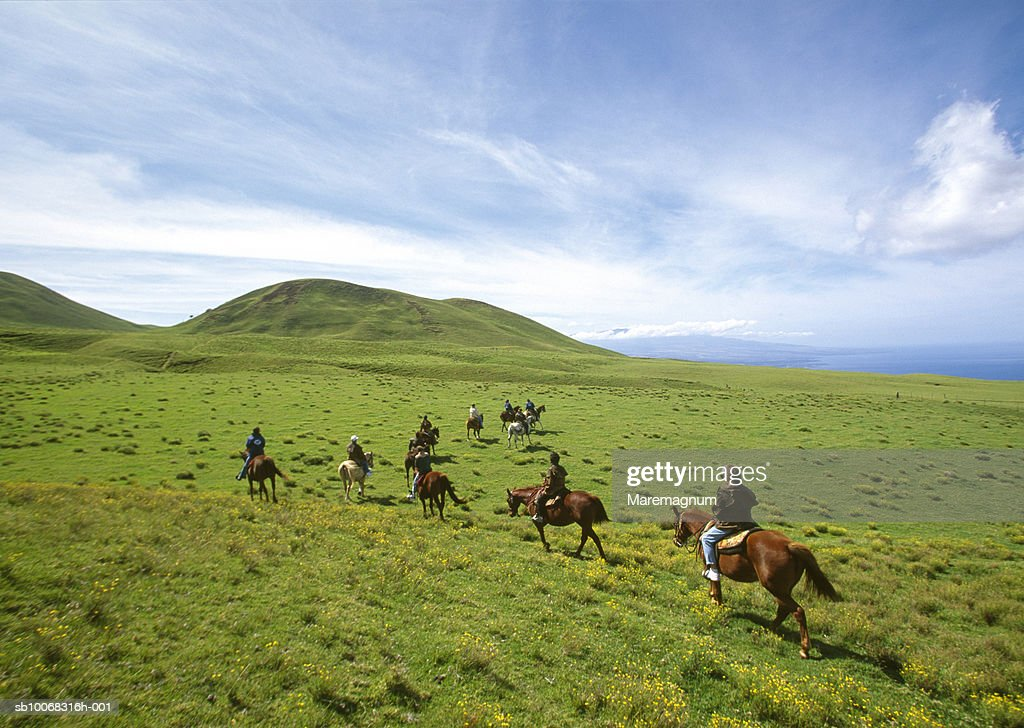 USA, Hawaii, Big Island, North Kohala, people riding horses : Stock Photo