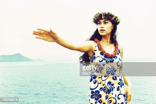 USA, Hawaii, female hula dancer performing near ocean : Stock Photo