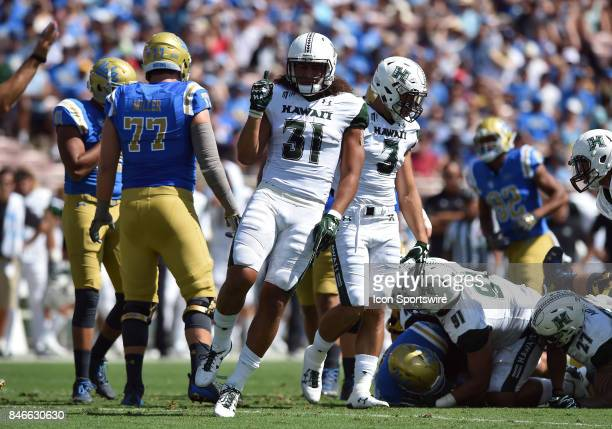 Hawai'i Jahlani Tavai celebrates after making a stop during a college football game between the Hawai'i Rainbow Warriors and the UCLA Bruins on...