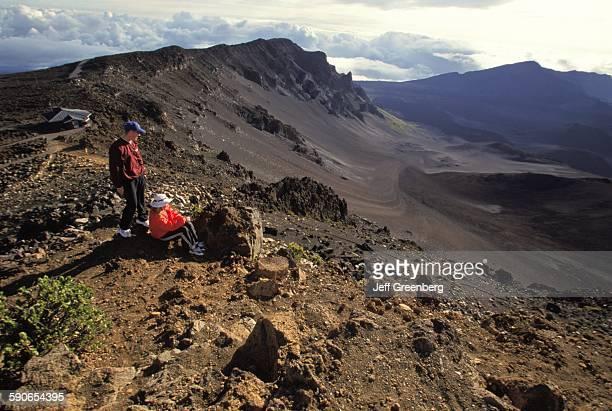 Hawaii Maui Haleakala National Park Teen Hikers Watch Sunrise At 10000 Ft