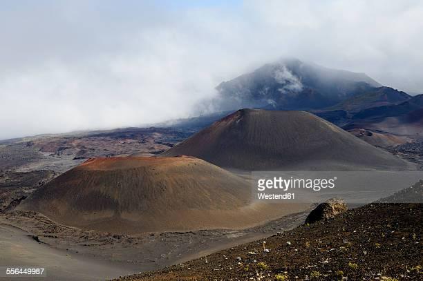 USA, Hawaii, Maui, Haleakala, volcanic landscape with clouds and cinder cones