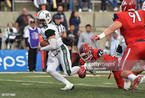 Hawaii quarterback Dru Brown is taken down by Fresno State defensive back Stratton Brown during the game between the Fresno State Bulldogs and the...