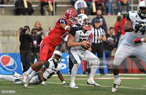 Hawaii quarterback Dru Brown is wrapped up by Fresno State defensive back Stratton Brown during the game between the Fresno State Bulldogs and the...