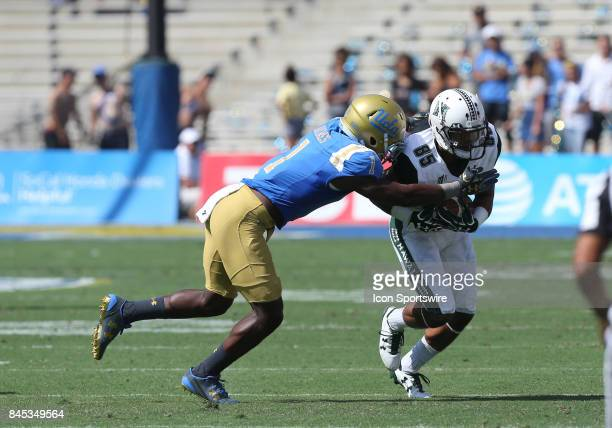 Hawai'i Rainbow Warriors Marcus ArmstrongBrown makes a catch against UCLA Bruins Darnay Holmes during the game on September 09 at the Rose Bowl in...