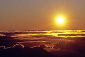 Hawaii, Sunball shining over clouds in dramtic sunset sky