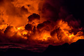Burning lava and fire flowing into the sea from the Kilauea Volcanic eruption in Hawaii on the Big Island