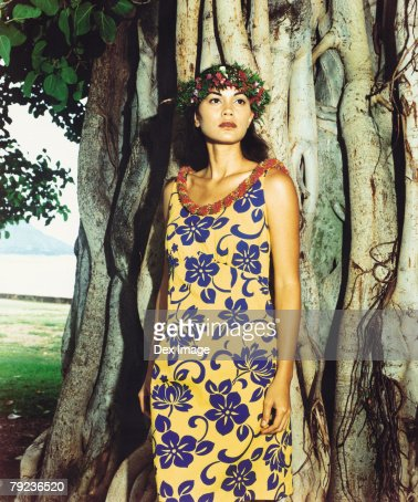 Hawaiian female wearing traditional hula attire. : Stock Photo