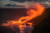 Spectacular evening view of the lava from the Kilauea volcano, flowing in the Pacific ocean near Kalapana on the south coast of the Big Island of Hawaii.