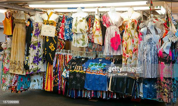 Hawaiian print clothing for sale on a market stall