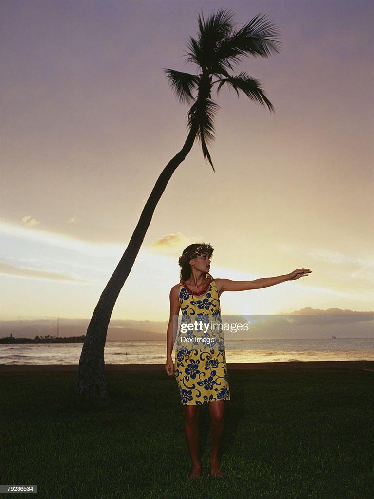 Hawaiian woman dancing at sunset : Stock Photo