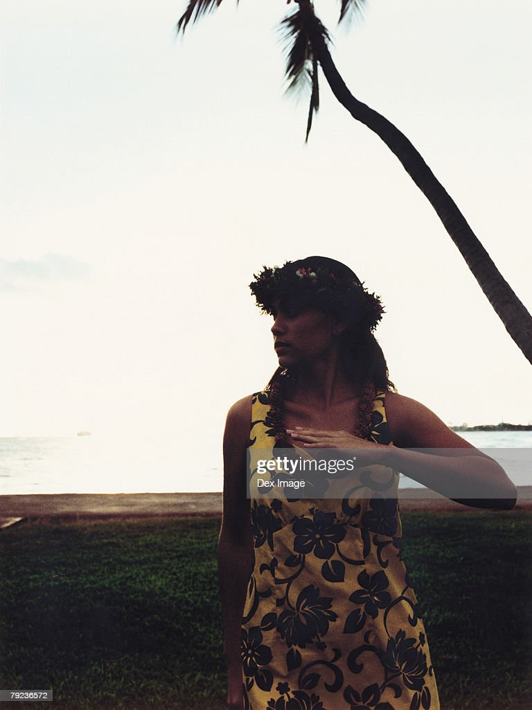 Hawaiian woman dancing at sunset : Stock Photo