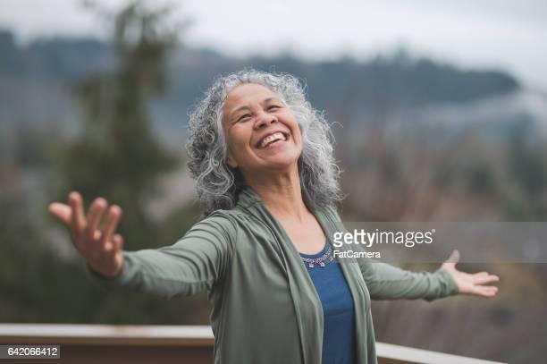 Hawaiian woman doing yoga pose outside