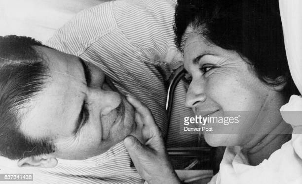 Hawaiians Aid Denverites Mrs Cora Montoya smiles up at her husband Peter from her bed in a hospital in Honolulu Hawaii where she is recovering from a...