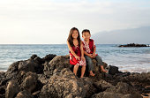 Brother and sister on a beach in Maui.