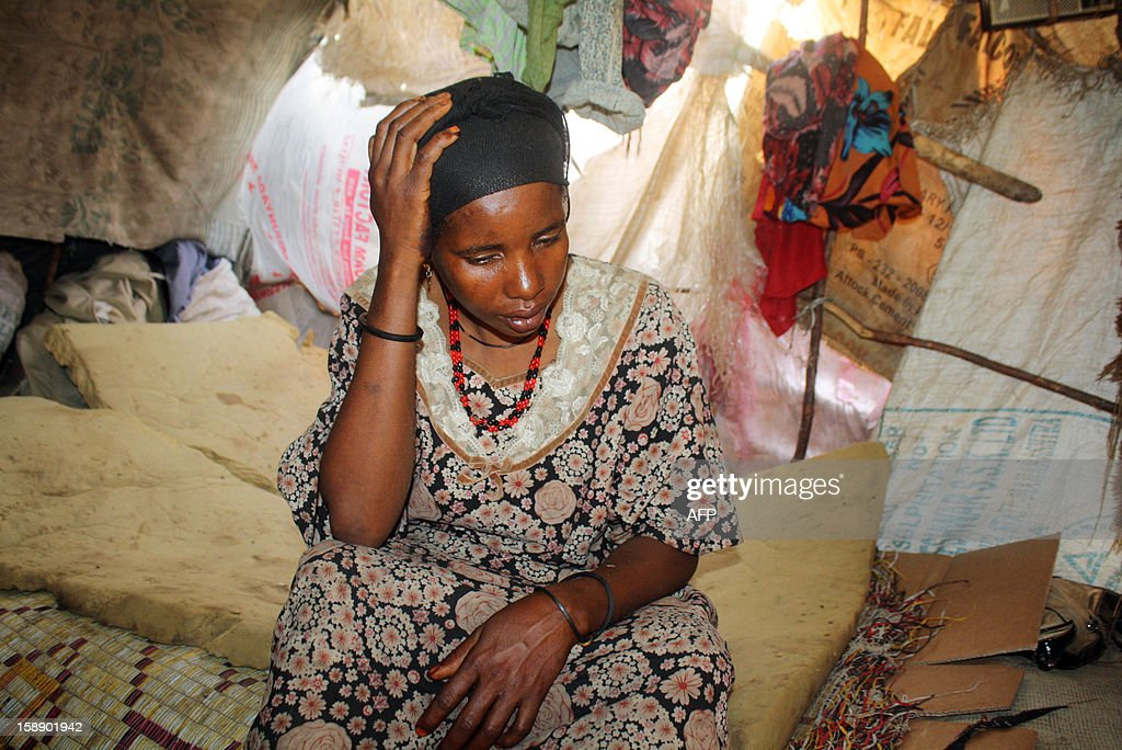 Haway Hassan Aliyow, who was raped by Somali security forces, rests inside a makeshift shelter in southern Mogadishu on December 31, 2012. Haway Hassan Aliyow says she was raped in the Afgoye suburb as she travelled to Mogadishu from Bay region. Rape cases brought against Somali military forces have increased since Somali military forces with AMISOM defeated Al-Shabab islamist militants. Most rape cases have been reported in the lower Shabelle region and the accused have been primarily Somali military officers. The Shabab militant group are seizing women and girls as spoils of war, gang-raping and abusing them as part of its reign of terror in southern Somalia, according to victims, aid workers and United Nations officials. AFP PHOTO / ABDURASHID ABDULLE ABIKAR