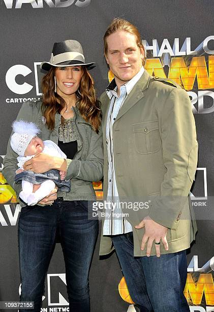 A J Hawk and family arrive at the 1st Annual Hall of Game Awards Hosted by the Cartoon Network at the Barker Hanger on February 21 2011 in Santa...