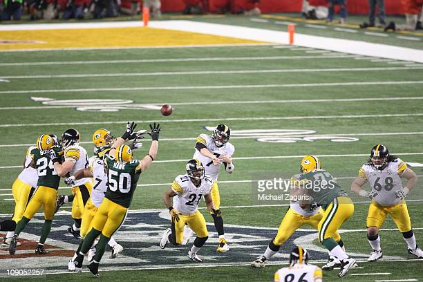 J Hawk of the Green Bay Packers bats down Ben Roethlisberger of the Pittsburgh Steelers pass during Super Bowl XLV at Cowboy Stadium on February 6...