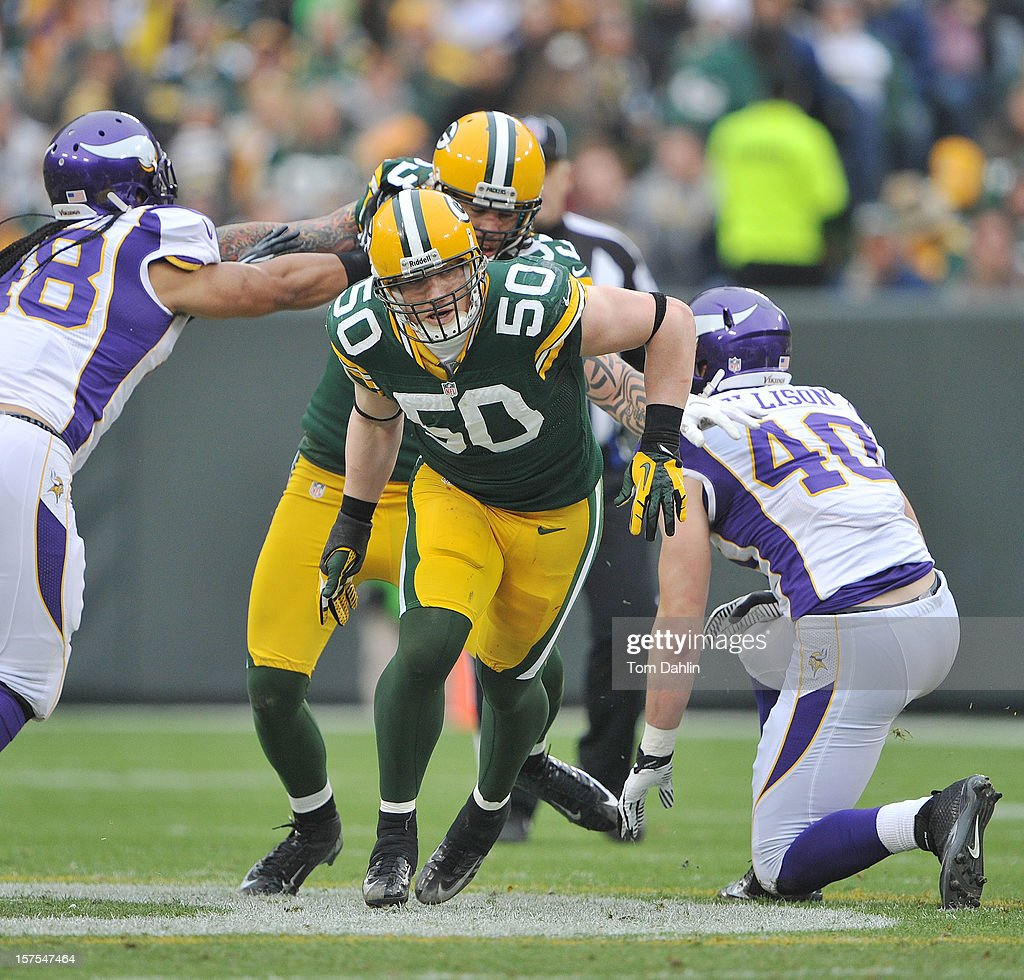 A.J. Hawk #50 of the Green Bay Packers breaks through the line during an NFL game against the Minnesota Vikings at Lambeau Field on December 2, 2012 in Green Bay, Wisconsin.