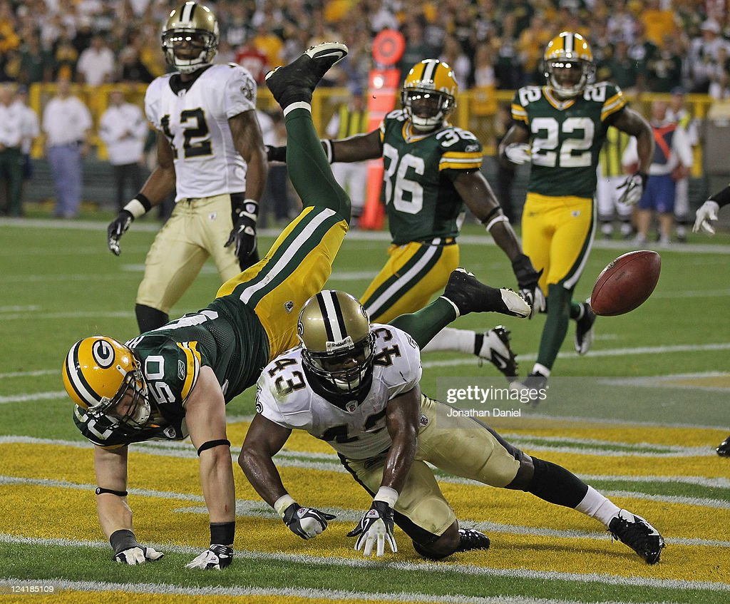 <a gi-track='captionPersonalityLinkClicked' href=/galleries/search?phrase=A.J.+Hawk&family=editorial&specificpeople=648187 ng-click='$event.stopPropagation()'>A.J. Hawk</a> #50 of the Green Bay Packers is called for pass interference on <a gi-track='captionPersonalityLinkClicked' href=/galleries/search?phrase=Darren+Sproles&family=editorial&specificpeople=583154 ng-click='$event.stopPropagation()'>Darren Sproles</a> #43 of the New Orleans Saints on the final play of the game during the NFL opening season game at Lambeau Field on September 8, 2011 in Green Bay, Wisconsin. The Packers defeated the Saints 42-34.