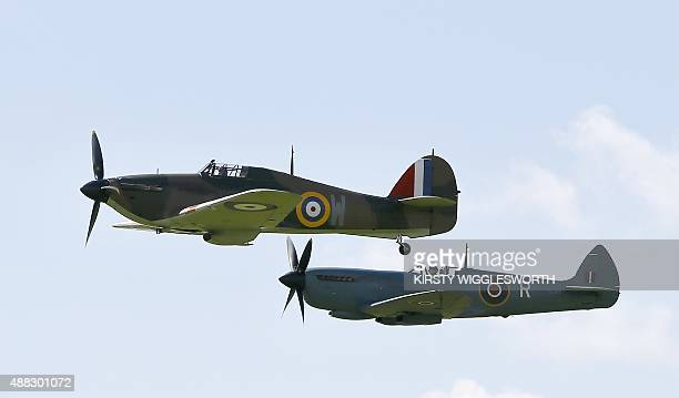 A Hawker Hurricane and a Supermarine Spitfire aircrafts fly during a display at Goodwood Aerodrome in West Sussex on September 15 2015 Prince Harry...