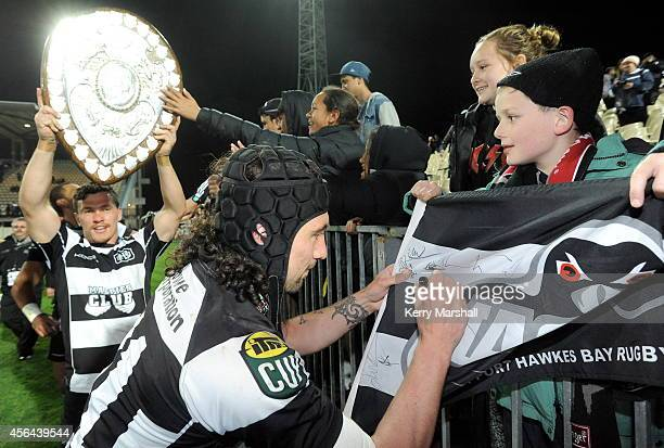 Hawkes Bay's Shannan Chase signs autographs after Hawkes Bay's retain the Ranfurly Shield against Wellington on October 1 2014 in Napier New Zealand