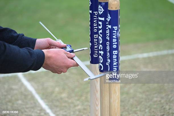 Hawkeye technician measuring the stumps during first day of the 2nd Investec Ashes Test between England and Australia at Lord's Cricket Ground London...