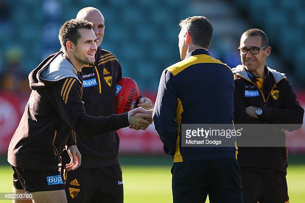 Hawks Captain Luke Hodge and Eagles coach Adam Simpson shake hands during the round 12 AFL match between the Hawthorn Hawks and the West Coast Eagles...