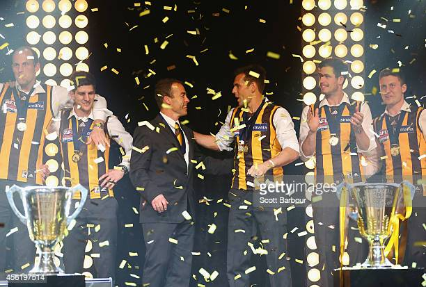 Hawks captain Luke Hodge and Hawks coach Alastair laugh as they are presented to guests at the Hawthorn Hawks AFL Grand Final function at Crown...