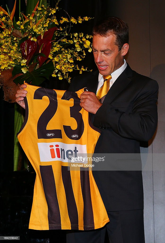 Hawks coach Alastair Clarkson looks at the jumper of <a gi-track='captionPersonalityLinkClicked' href=/galleries/search?phrase=Lance+Franklin&family=editorial&specificpeople=561332 ng-click='$event.stopPropagation()'>Lance Franklin</a> on stage during the Hawthorn Hawks Season Launch and Hall of Fame presentation at Encore St Kilda on March 21, 2013 in Melbourne, Australia.