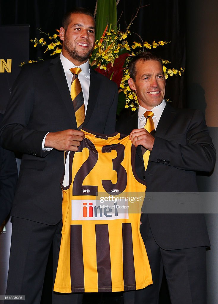 Hawks coach Alastair Clarkson presents <a gi-track='captionPersonalityLinkClicked' href=/galleries/search?phrase=Lance+Franklin&family=editorial&specificpeople=561332 ng-click='$event.stopPropagation()'>Lance Franklin</a> his jumper on stage during the Hawthorn Hawks Season Launch and Hall of Fame presentation at Encore St Kilda on March 21, 2013 in Melbourne, Australia.