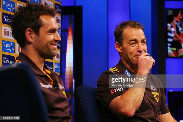 Hawks coach Alastair Clarkson reacts next to Luke Hodge of the Hawks during the AFL Finals Series Launch at Fox Footy on September 1 2014 in...