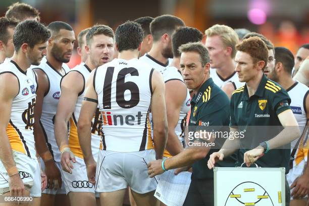 Hawks coach Alastair Clarkson talks to players during the round three AFL match between the Gold Coast Suns and the Hawthorn Hawks at Metricon...