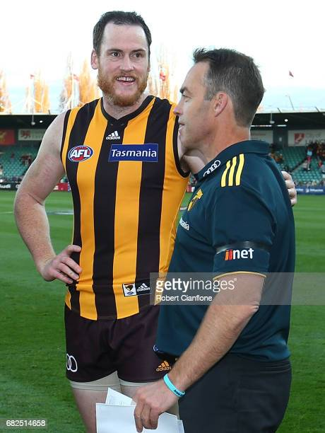 Hawks head coach Alastair Clarkson acknowledges Jarryd Roughead of the Hawks after the Hawks defeated the Lions during the round eight AFL match...