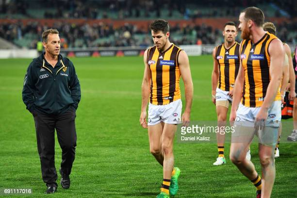 Hawks head coach Alastair Clarkson chats with Jarryd Roughead of the Hawks after the round 11 AFL match between the Port Adelaide Power and the...
